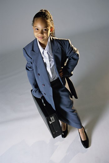 Stock Photo: 1525R-82173 Portrait of a young girl dressed as a businesswoman