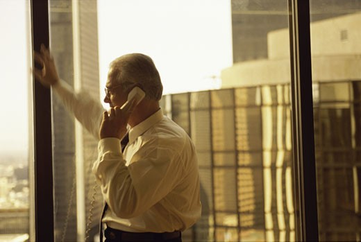 Stock Photo: 1525R-82194 Businessman talking on a landline telephone
