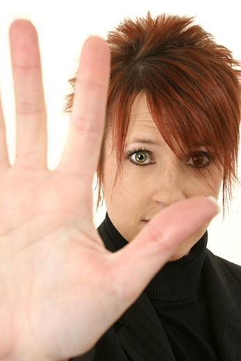 Stock Photo: 1525R-82426 Portrait of a mid adult woman making a stop hand gesture