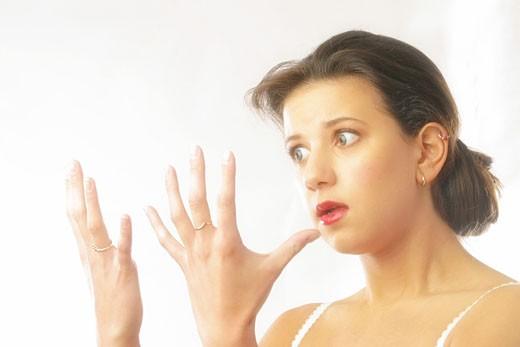 EWoman applying make up : Stock Photo