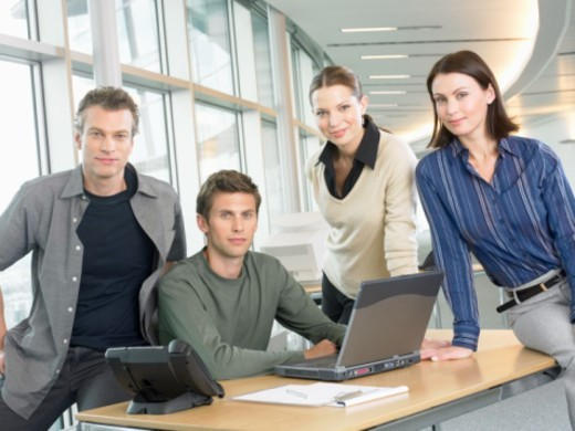 Stock Photo: 1527R-010332 Group Portrait of Businessmen and Women in an Open Plan Office