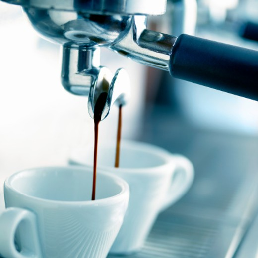 Stock Photo: 1527R-010475 Close-Up of a Coffee Maker Pouring Coffee Into Two Espresso Cups