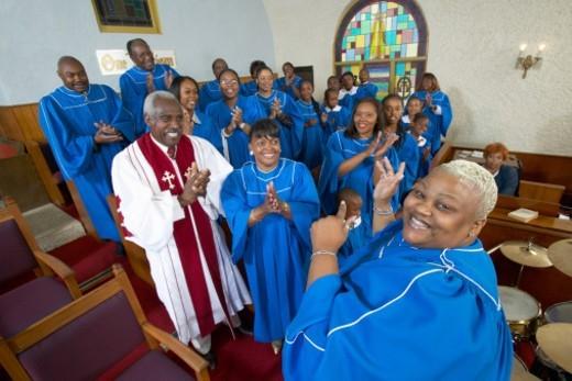 Gospel Singer Leading a Choir in a Church Service : Stock Photo