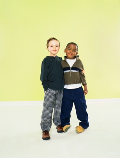 Portrait of Two Young Boys Standing Side by Side With Their Arms Around Each Other : Stock Photo