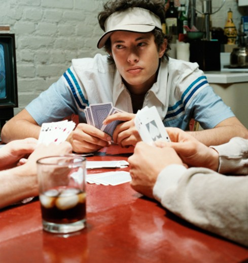 Young Man Playing Poker : Stock Photo