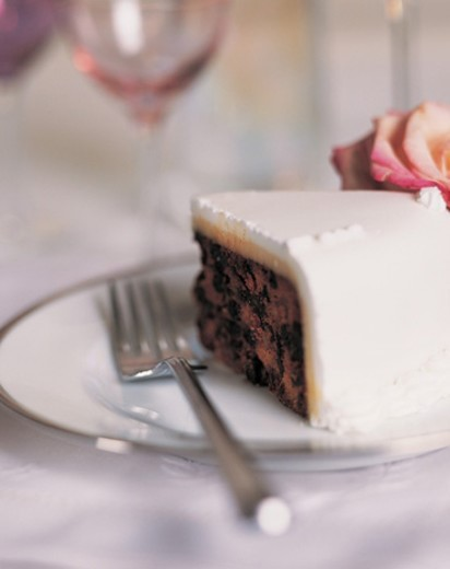 Slice of Wedding Cake on a Plate With a Fork : Stock Photo