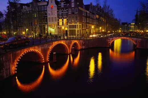 Illuminated Bridges Reflected in the Canals at Night, Keizersgracht, Amsterdam, Netherlands : Stock Photo