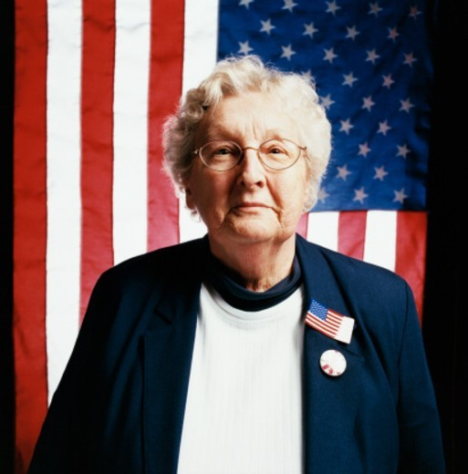 Portrait of a Senior Woman in Front of Stars and Stripes Flags : Stock Photo