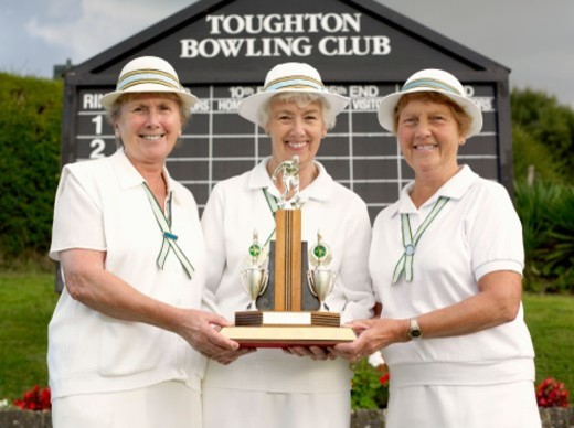 Portrait of a Group of Senior Women Wearing Lawn Bowling Sportswear and Holding a Trophy : Stock Photo