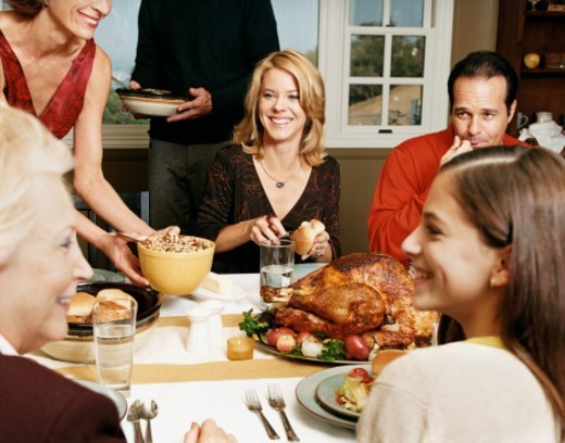 Stock Photo: 1527R-015222 Family Enjoying a Thanksgiving Meal Together