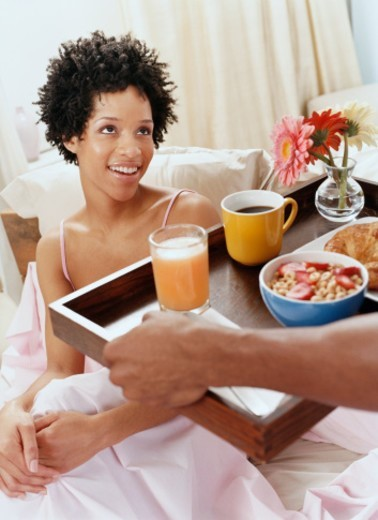 Man Giving His Partner Breakfast in Bed : Stock Photo