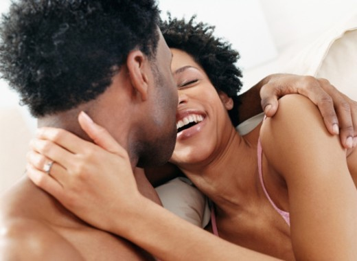 Adoring Couple Embracing in Bed : Stock Photo