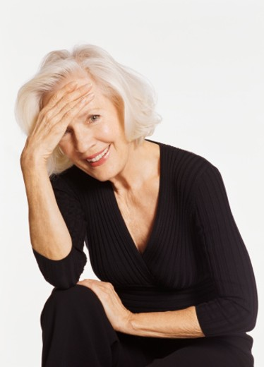 Studio Shot of a Senior Woman Leaning on Her Elbow : Stock Photo