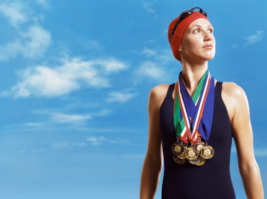 Stock Photo: 1527R-016801 Female Swimmer Wearing Gold Medals Around Her Neck
