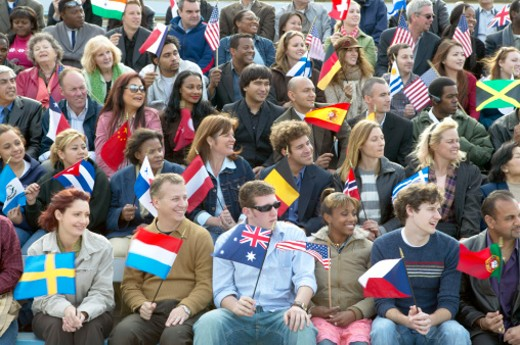 Stock Photo: 1527R-017071 Large Group of People Sitting in Rows and Holding International Flags