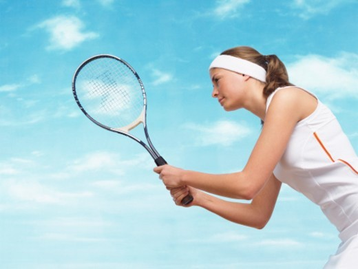 Side View of a Female Tennis Player Holding a Tennis Racket : Stock Photo