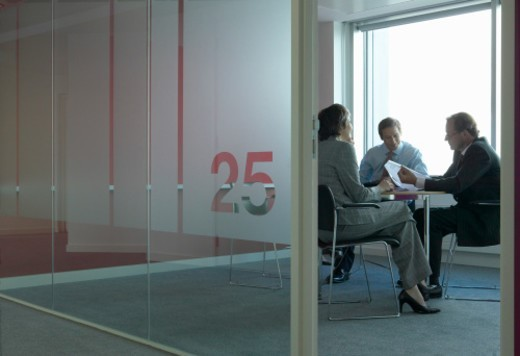 Stock Photo: 1527R-017587 Businesswoman With Businessmen at a Table in a Meeting Room