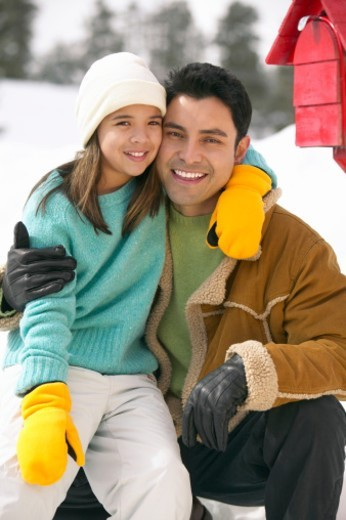 Portrait of a Father and Daughter by a Mail Box in the Snow : Stock Photo