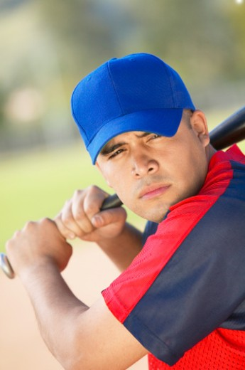 Baseball Player Preparing to Swing a Baseball Bat : Stock Photo