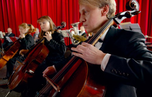 Stock Photo: 1527R-020206 Male and Female Cellists Performing in an Orchestra