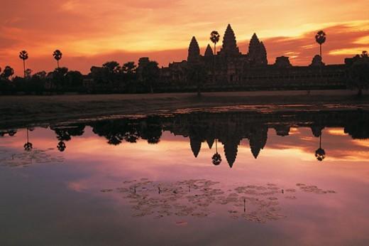 Angkor Wat Reflected in Water at Sunrise, Cambodia : Stock Photo