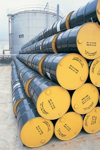 Stock Photo: 1527R-03212 Large Stack of Oil Drums in a Line at an Oil Refinery