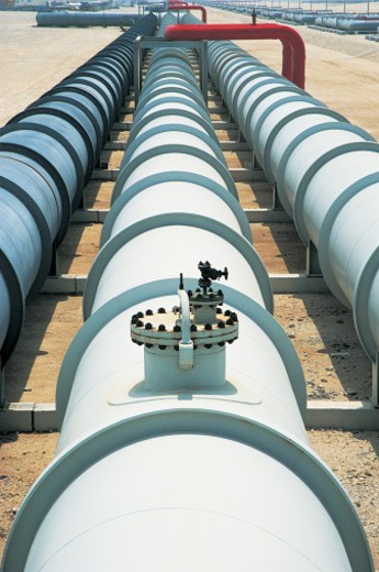 Three Long Pipelines in Parallel at an Oil Refinery : Stock Photo