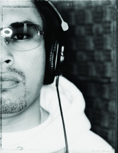 Portrait of a Rapper Wearing Headphones in a Recording Studio : Stock Photo