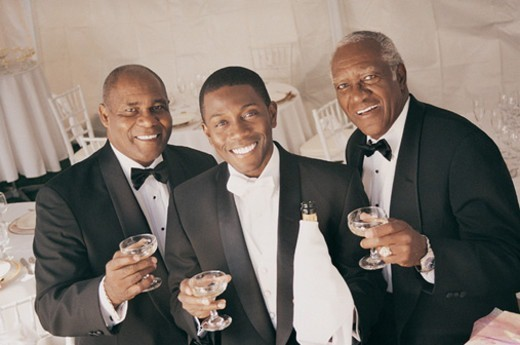 Three Men Drink a Toast Indoors at a Wedding Reception : Stock Photo
