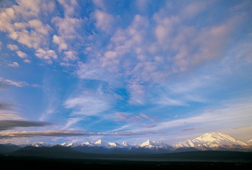 Stock Photo: 1527R-04601 Cloudy Sky Over a Snow Covered Mountain Range With Mt McKinley in the Background, Denali National Park, Alaska, USA