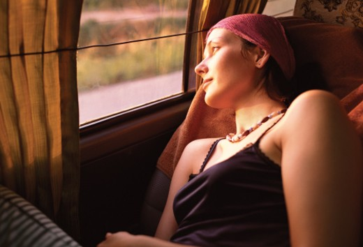 Young Female Passenger Looking Out the Window Serenely : Stock Photo