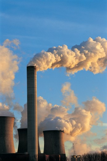 Steam Pouring From Cooling Towers and a Smokestack of a Power Station : Stock Photo