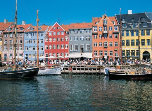 Stock Photo: 1527R-04943 Large Group of People at the Houses at Nyhavn Harbour, Copenhagen, Denmark