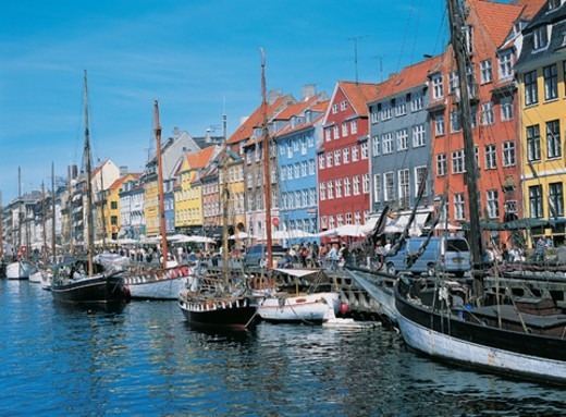 Tourism at the Houses on Nyhavn Harbour, Copenhagen, Denmark : Stock Photo