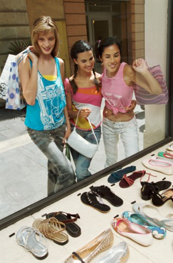 Stock Photo: 1527R-07925 Three Teenage Women Looking at a Window Display in a Shoe Shop