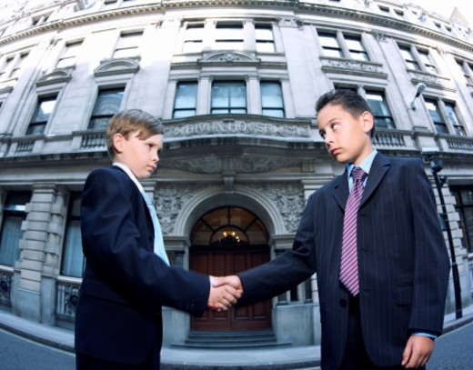 Two Boys Dressed as Businessman Shaking Hands : Stock Photo