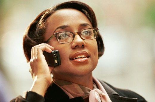 Stock Photo: 1527R-08983 Woman Wearing Glasses and Using a Mobile Phone