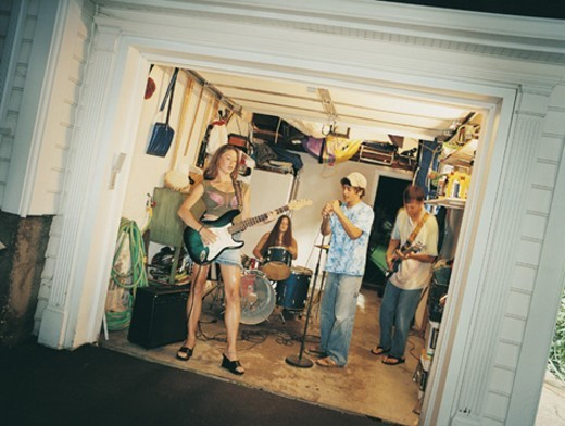 Rock and Roll Band Playing in a Garage : Stock Photo
