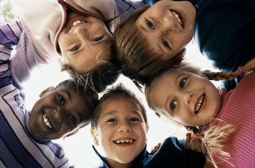 Below View of Children Huddled Together : Stock Photo