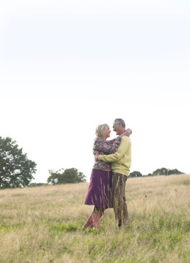 Stock Photo: 1527R-09543 Couple Embracing Each Other in a Field