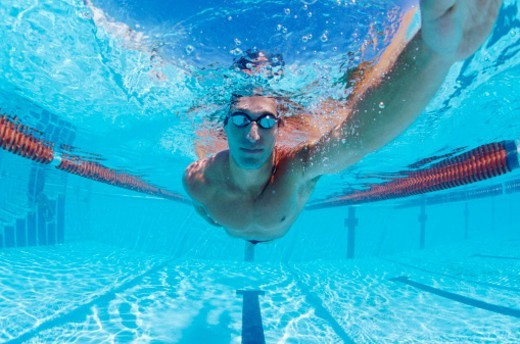 Close up of a Man Swimming in a Swimming Pool : Stock Photo