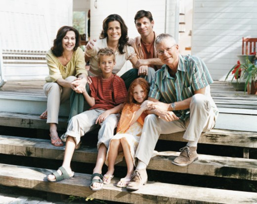 Portrait of a Family Sitting on the Patio Steps of Their Home : Stock Photo
