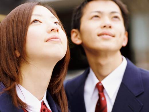 Two School Pupils Looking Up : Stock Photo