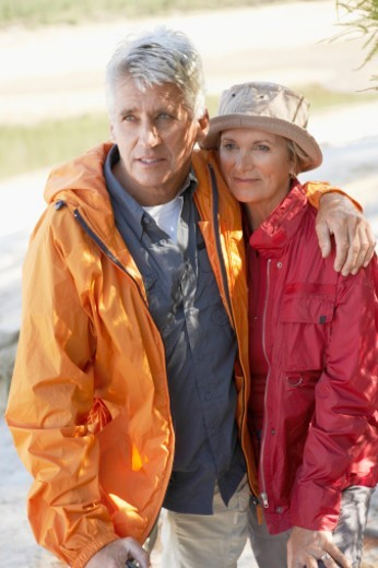Stock Photo: 1527R-1078742 Senior Couple Standing Together, with the Man's Arm Around the Woman's Shoulders