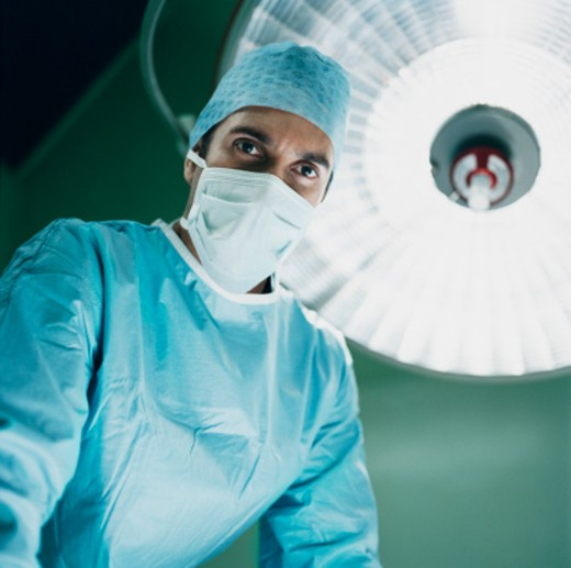 Male Surgeon Wearing a Protective Mask : Stock Photo