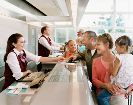 Passengers at Airport Check-in Desk : Stock Photo