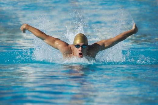 Man Swimming in a Swimming Pool : Stock Photo