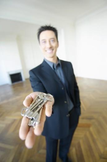 Stock Photo: 1527R-1079398 Estate Agent Holding Keys