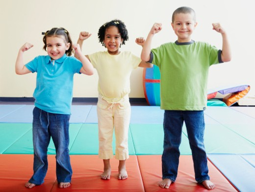 Stock Photo: 1527R-1079628 Three Young Friends Showing Off Their Muscles in a Nursery