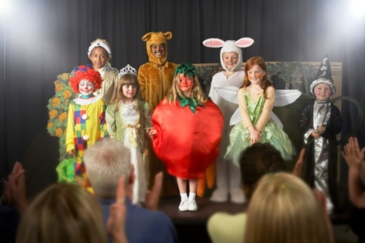 Stock Photo: 1527R-1082938 Group of children (11-14) wearing costumes on stage, portrait